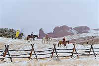 Cowboys with Two Young Cowboys Riding Horses in Snow, Rocky Mountains, Wyoming, USA Stock Photo - Premium Royalty-Freenull, Code: 600-08026179