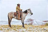 Cowgirl Riding Horse in Snow, Rocky Mountains, Wyoming, USA Stock Photo - Premium Royalty-Freenull, Code: 600-08026186