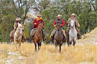 Cowboys and Cowgirls Riding Horses, Rocky Mountains, Wyoming, USA Stock Photo - Premium Royalty-Freenull, Code: 600-08026194