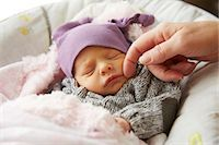 Woman's Hand Caressing Baby Girl Face Stock Photo - Premium Rights-Managednull, Code: 822-08026276