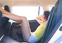 Woman Reclining in Car Back Seat with Legs Raised Stock Photo - Premium Rights-Managednull, Code: 822-08026324