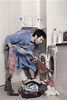 a man empties the washing machine Stock Photo - Premium Rights-Managednull, Code: 877-08026441
