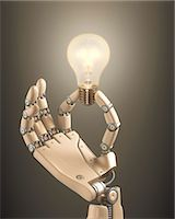 Robotic hand holding a light bulb Stock Photo - Premium Royalty-Freenull, Code: 679-08027037