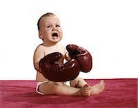 1960s CRYING BABY WEARING BOXING GLOVES Stock Photo - Premium Rights-Managednull, Code: 846-08030379