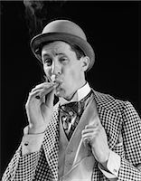 1910s 1920s CHARACTER MAN INHALING CIGAR CON MAN BOWLER HAT FANCY SUIT CRAVAT Stock Photo - Premium Rights-Managednull, Code: 846-08030429