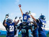 football team - Teenage and young adult american football players celebrating with shoulder carry Stock Photo - Premium Royalty-Freenull, Code: 614-08031100