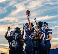 football team - Teenage and young male american football team celebrating together Stock Photo - Premium Royalty-Freenull, Code: 614-08031110