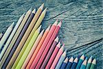 Crayons on wooden table background