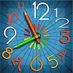Colorful clock with clock hands in the shape of colored pencils - concept of back to school!