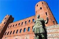 Roman statue of Julius Caesar and ancient ruins of Palatine Towers in Torino, Piemonte, Italy Stock Photo - Royalty-Freenull, Code: 400-08049828