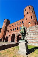 Roman statue of Julius Caesar and ancient ruins of Palatine Towers in Torino, Piemonte, Italy Stock Photo - Royalty-Freenull, Code: 400-08049830