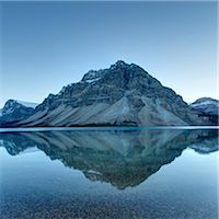 scenic view - Reflection of mountains on tranquil lake surface Stock Photo - Premium Royalty-Freenull, Code: 613-08057366
