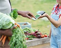 Man paying for vegetables. Stock Photo - Premium Royalty-Freenull, Code: 613-08057412