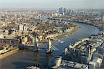 Elevated view of the River Thames looking East towards Canary Wharf with Tower Bridge in the foreground, London, England, United Kingdom, Europe