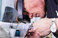 Close up of jewellery craftsman using miniature blowtorch Stock Photo - Premium Royalty-Freenull, Code: 649-08060764