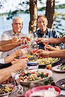 setting kitchen table - People toasting during meal Stock Photo - Premium Royalty-Freenull, Code: 6102-08062943