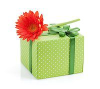 silver box - Orange gerbera flower over gift box. Isolated on white background Stock Photo - Royalty-Freenull, Code: 400-08072946