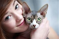 France, teen and sphinx cat. Stock Photo - Premium Rights-Managednull, Code: 877-08079023