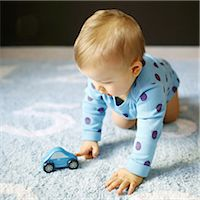 A 15 months baby boy playing with a car Stock Photo - Premium Rights-Managednull, Code: 877-08079115