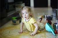 A 2 years old little girl posing in a kitchen in which she made the mess Stock Photo - Premium Rights-Managednull, Code: 877-08079198
