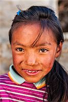 Portrait of young Sherpa girl in Everest Region Stock Photo - Premium Royalty-Freenull, Code: 6106-08080795
