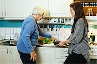 Grandmother and granddaughter preparing food in kitchen Stock Photo - Premium Royalty-Freenull, Code: 698-08081495