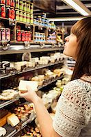 Woman shopping cheese in supermarket Stock Photo - Premium Royalty-Freenull, Code: 698-08081811