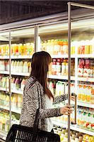 Woman shopping at freezer section in supermarket Stock Photo - Premium Royalty-Freenull, Code: 698-08081820