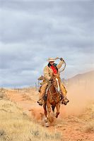 Cowgirl Riding Horse with Rope in Hand, Shell, Wyoming, USA Stock Photo - Premium Royalty-Freenull, Code: 600-08082910