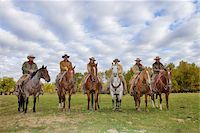 Cowboys and Cowgirls in a row Sitting on their Horses, Shell, Wyoming, USA Stock Photo - Premium Royalty-Freenull, Code: 600-08082917