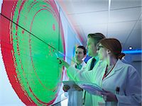 Scientists studying graphical display of silicon wafer on screens Stock Photo - Premium Royalty-Freenull, Code: 649-08085271