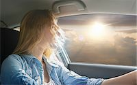 Woman driving car and watching sunset Stock Photo - Premium Royalty-Freenull, Code: 649-08085864