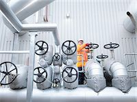pipework - Worker turning valve of gas fired power station Stock Photo - Premium Royalty-Freenull, Code: 649-08086291
