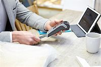 Man buying online with credit card in picture framers workshop Stock Photo - Premium Royalty-Freenull, Code: 649-08086953