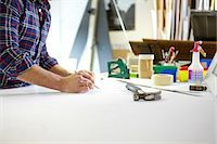 Mid adult man writing measurement on workbench in picture framers workshop Stock Photo - Premium Royalty-Freenull, Code: 649-08086958