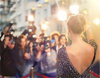 Celebrity waving at paparazzi photographers at event Stock Photo - Premium Royalty-Freenull, Code: 6113-08088172