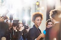 Celebrity being interviewed and photographed by paparazzi at event Stock Photo - Premium Royalty-Freenull, Code: 6113-08088184