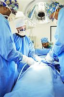 Surgeons performing surgery in operating room Stock Photo - Premium Royalty-Freenull, Code: 6113-08088302