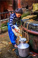 Young Nepali girl getting water from a well Stock Photo - Premium Royalty-Freenull, Code: 6106-08100374