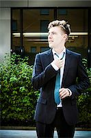 Young businessman adjusting his tie, Munich, Bavaria, Germany Stock Photo - Premium Royalty-Freenull, Code: 6115-08100760
