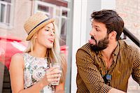 Happy young couple sticking out tongues Stock Photo - Premium Royalty-Freenull, Code: 6115-08100925