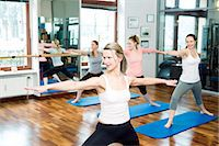 fitness   mature woman - Group of women doing Pilates exercises arms outstretched Stock Photo - Premium Royalty-Freenull, Code: 6115-08105156