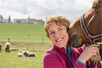 Close-up of woman with her dog in ranch, Bavaria, Germany Stock Photo - Premium Royalty-Freenull, Code: 6121-08106664