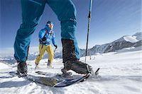 extreme terrain - Ski mountaineers climbing on snowy mountain in snow storm, Zell Am See, Austria Stock Photo - Premium Royalty-Freenull, Code: 6121-08107003