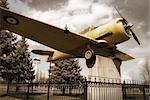 A vintage edit of an old historic war plane on display in a public park, located in Smiths Falls, Canada.