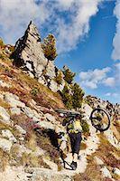 Mountain biker carrying bike, Valais, Switzerland Stock Photo - Premium Royalty-Freenull, Code: 649-08119082