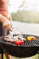 Man having barbecue Stock Photo - Premium Royalty-Freenull, Code: 6102-08121005