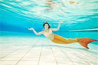 Portrait of Teenage Girl with Mermaid Tail Underwater Stock Photo - Premium Rights-Managednull, Code: 700-08122202