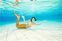 Portrait of Teenage Girl with Mermaid Tail Underwater Stock Photo - Premium Rights-Managednull, Code: 700-08122203
