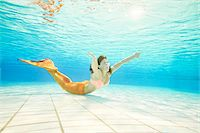 Portrait of Teenage Girl with Mermaid Tail Underwater Stock Photo - Premium Rights-Managednull, Code: 700-08122204